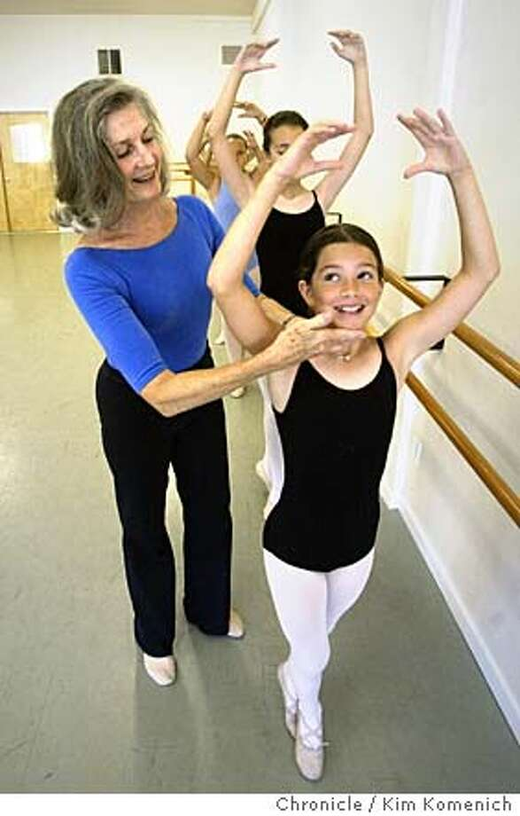 Virginia Stapleton adjusts Madeline Cericola's (age 10) position.  Virginia Stapleton was formerly a principal with the San Francisco Ballet. She has run Stapleton Perfoming Arts in San Rafael for the past 20 years. We watch her give a class to a group of 10 year-olds. Photo by Kim Komenich in San Rafael. Photo: Kim Komenich