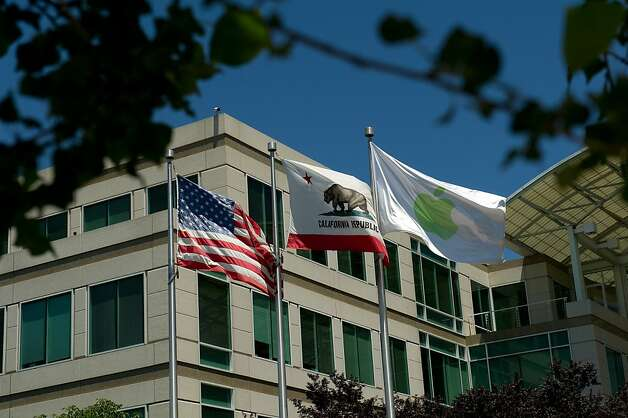 Flags fly at the entrance to Apple Inc. headquarters in Cupertino, California, U.S., on Friday, July 15, 2011. Apple Inc. is set to post a 69 percent jump in quarterly profit when it reports results today, after record buying of the iPad and Mac computermade up for weaker demand for its aging iPhone 4. Photo: David Paul Morris, Bloomberg