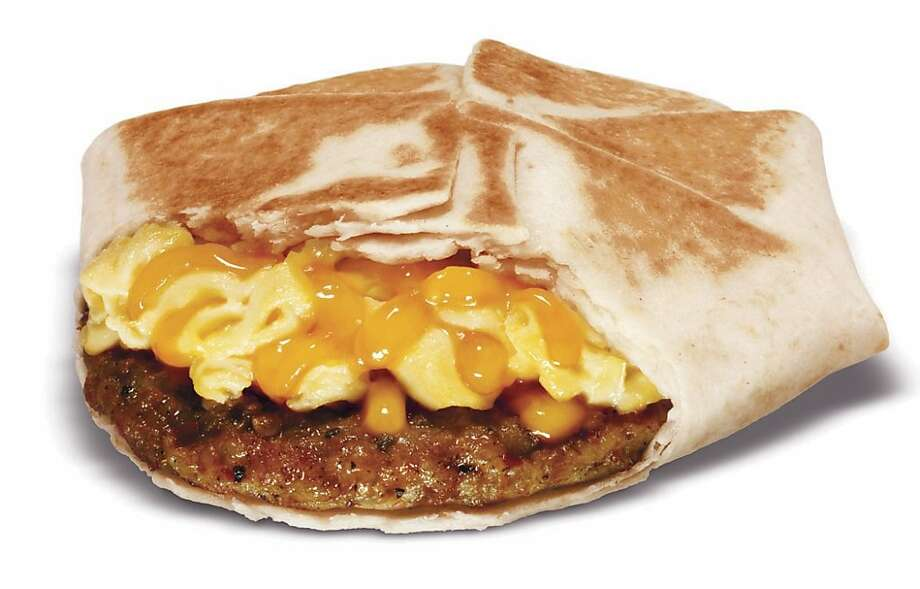 This product image provided by Taco Bell Corp., shows Taco Bell's new Johnsonville sausage and egg wrap, one of the items the fast-food chain will be offering on its new breakfast menu which debuts Thursday, Jan. 26, 2012. Photo: Taco Bell Corp., Associated Press