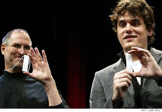 Apple Computer Inc. CEO Steve Jobs, left, and musician John Mayer unveil the new iPod Shuffle after Jobs gave the keynote address and Mayer performed during the Conference and Expo at the Moscone Center Esplanade in San Francisco on Tuesday, Jan. 11, 2005. (AP Photo/Jeff Chiu) Photo: JEFF CHIU