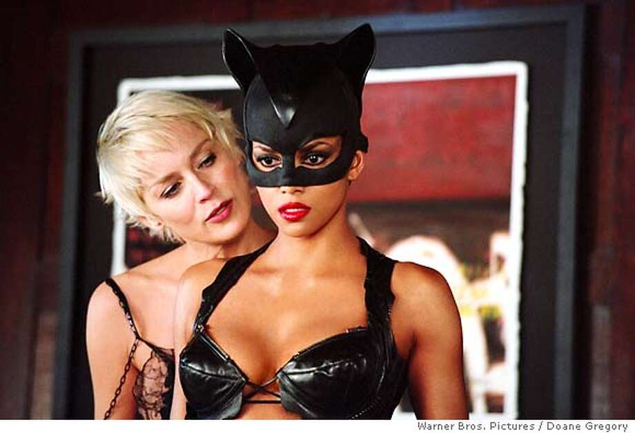 "SHARON STONE (left) and HALLE BERRY in Warner Bros. Pictures' action adventure ""Catwoman.""  PHOTOGRAPHS TO BE USED SOLELY FOR ADVERTISING, PROMOTION, PUBLICITY OR REVIEWS OF THIS SPECIFIC MOTION PICTURE AND TO REMAIN THE PROPERTY OF THE STUDIO. NOT FOR SALE OR REDISTRIBUTION."