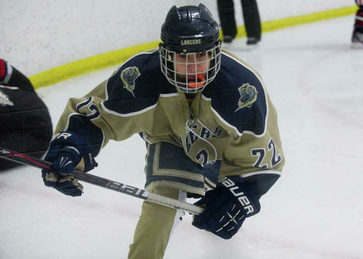 Notre Dame's Matt Khorasani moves along the boards as New Canaan and Notre Dame High Schools face off in a boys hockey game at Milford Ice Pavilion in Milford, Conn., January 26, 2012.