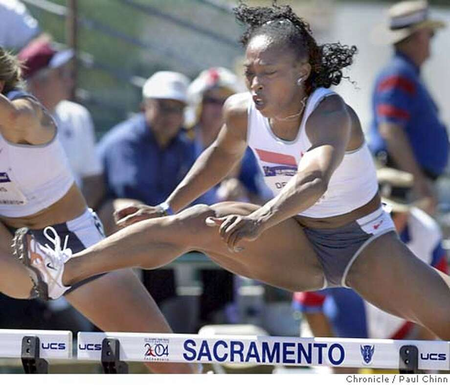 Gail Devers leaps over a hurdle in the semifinals of the women's 100m hurdle event. Devers' time of 12.70 qualifies her for the finals. Day 8 of competition in the U.S. Track and Field Trials in Sacramento on 7/18/04. PAUL CHINN/The Chronicle Photo: PAUL CHINN