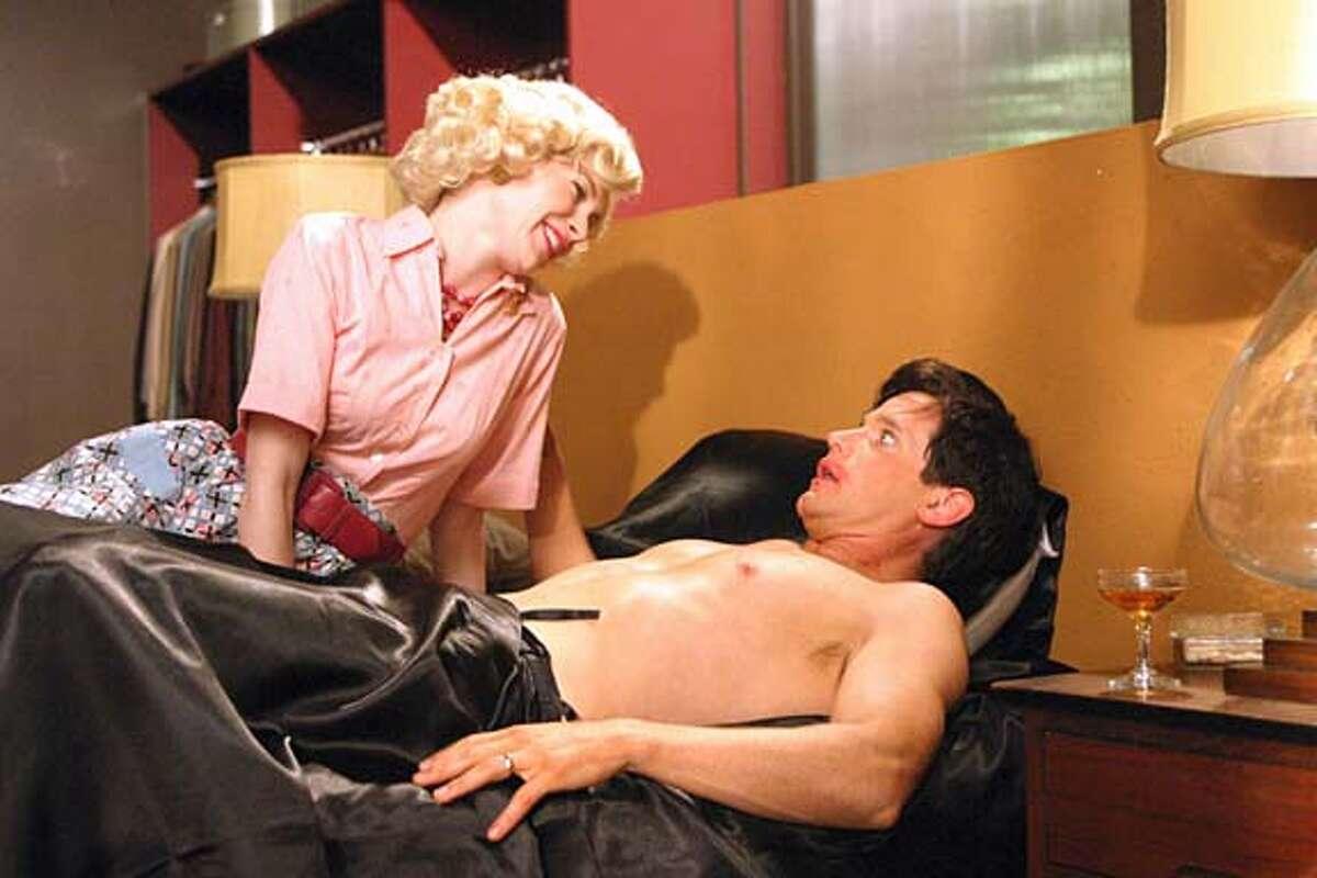 STRAIGHT07 STRAIGHT-JACKET: Guy (Matt Letscher) and Sally (Carrie Preston). REGENT RELEASING