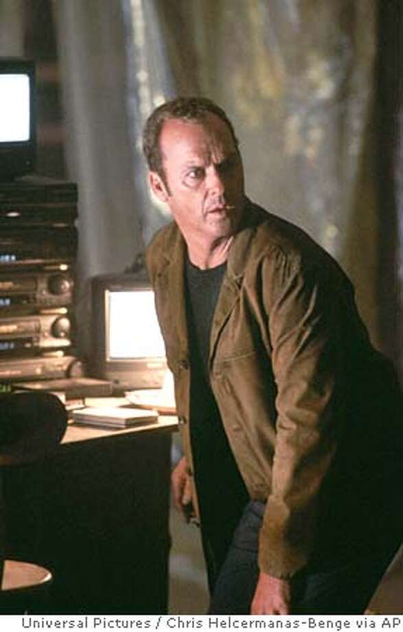 "In this photo provided by Universal Pictures, Jonathan Rivers (Michael Keaton) is contacted from beyond the grave by his murdered wife through the ""white noise"" on the radio in the paranormal thriller, ""White Noise."" (AP Photo/Universal Pictures/ Chris Helcermanas-Benge) Photo: CHRIS HELCERMANAS-BENGE"