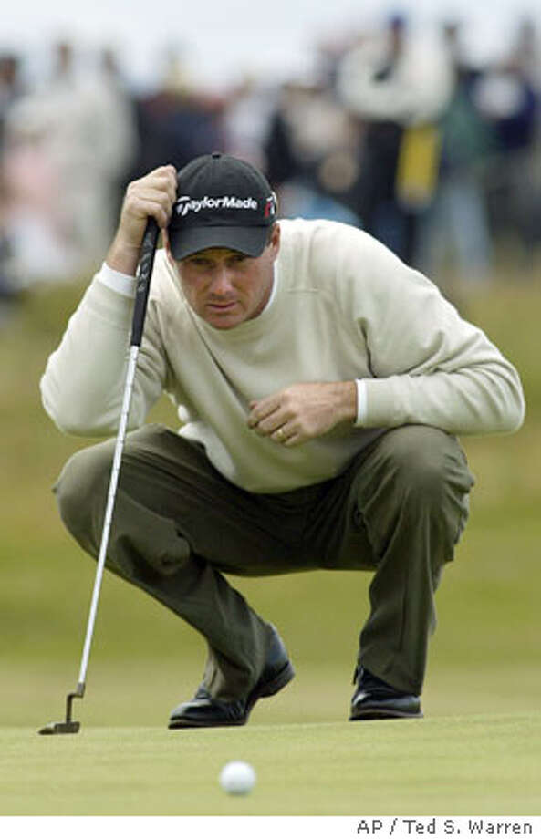 Todd Hamilton of the United States lines up a putt on the 3rd hole on the final day of the golf championship at Royal Troon golf course in Troon, Scotland Sunday July 18, 2004. (AP Photo/Ted S. Warren) ** EDITORIAL USE ONLY ** Photo: TED S. WARREN