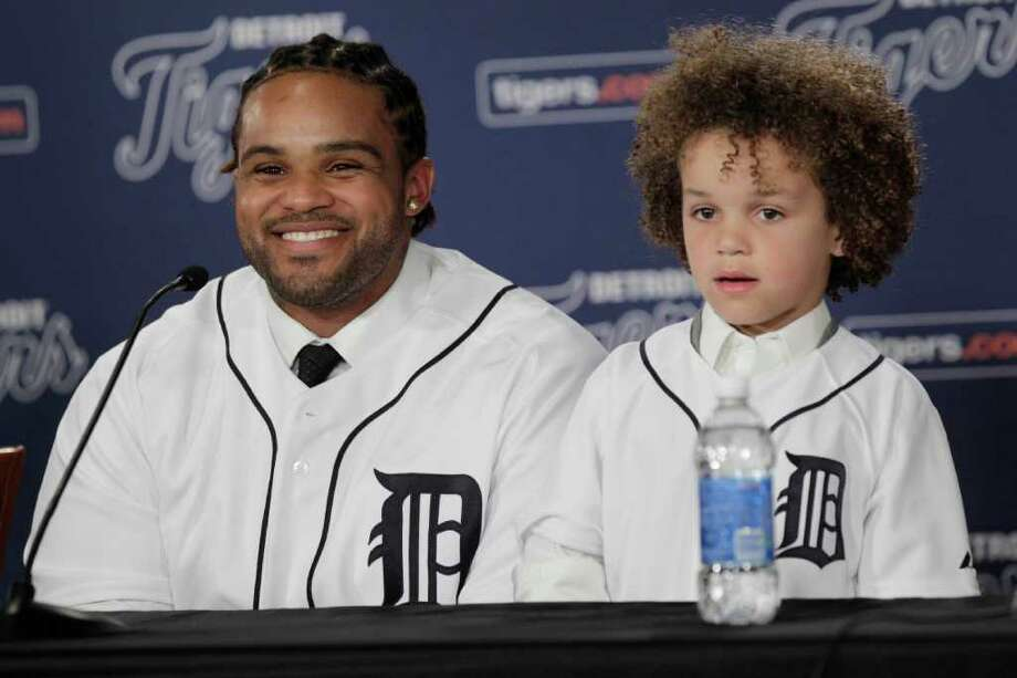 Prince Fielder sits next to his son Jadyn during his introduction to the media after finalizing a $214 million, nine-year contract with the Tigers. Photo: Carlos Osorio / AP