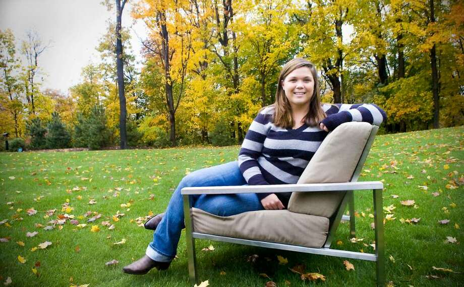 Alex Stevenson, a graduate of Darien High School and now a student at Fairfield University is a recovering drug addict.  She was a volleyball player at Darien High School and now plays club volleyball at Fairfield.  She sits in her backyard in Darien, Conn. on Wednesday, October 28,  2009 withe her parents Jayme and John Photo: Kathleen O'Rourke / Stamford Advocate