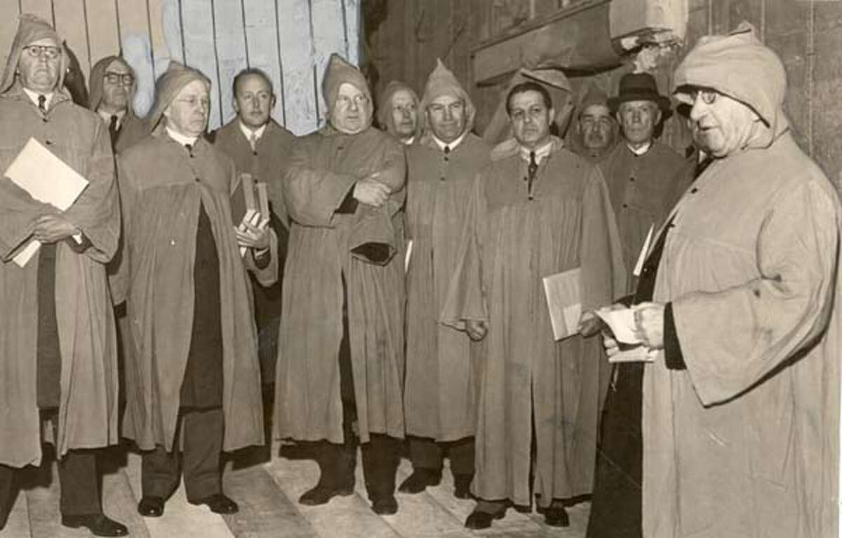 APRIL 16, 1934 BOHEMIAN CLUB MEMBERS DEDICATE NEW $1,000,000 HOME. LEFT TO RIGHT ARE FORMER PRESIDENT WILLIAM M. ABBOTT; FORMER VP O.C. HASLETT, FORMER PRESIDENT GEORGE T. KLINK, DIRECTOR ALEC J. YOUNG, FORMER PRESIDENT JOSEPH S. THOMPSON, WILLIAM P. DAY, ARCHITECT; FORMER PRESIDENT ROBERT C. NEWELL, FORMER PRESIDENT HAIG PATIGIAN, LEWIS P. HOBART, ARCHITECT; FORMER PRESIDENT WILLIAM SPROULE, SIRE AND FORMER PRESIDENT FRANK P. DEERING.