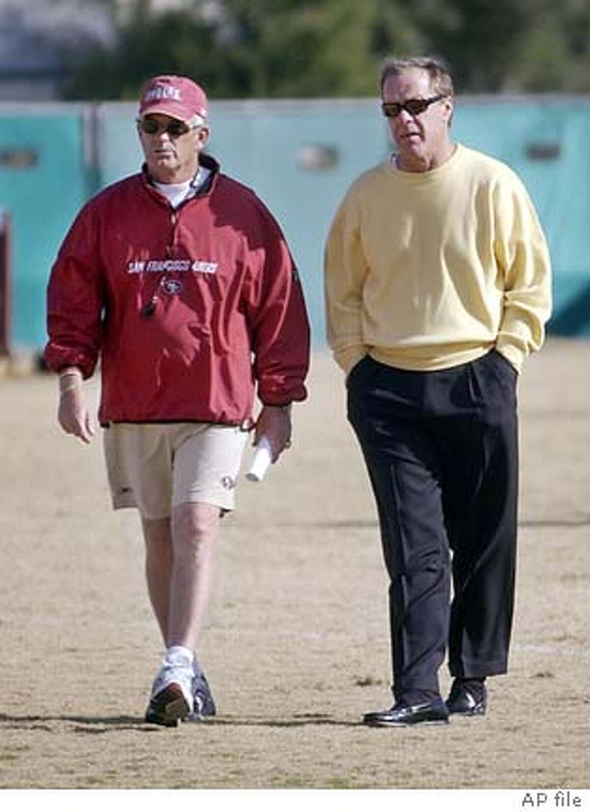 San Francisco 49ers coach Dennis Erickson, left, and 49ers general manager Terry Donahue, right, talk after practice at the 49ers training camp in Santa Clara, Calif., Wednesday, Dec. 15, 2004. Erickson withdrew from consideration for the vacant head coaching position at Mississippi after a two-hour meeting with the school's athletic director and chancellor on Tuesday night. He plans to finish the season with the 49ers, and still hopes to coach the team again next season. (AP Photo/Paul Sakuma) Ran on: 12-26-2004 The Chargers stuck with Marty Schottenheimer; should the 49ers do the same with Dennis Erickson (left) and Terry Donahue? Ran on: 12-26-2004 The Chargers stuck with Marty Schottenheimer; should the 49ers do the same with Dennis Erickson (left) and Terry Donahue?