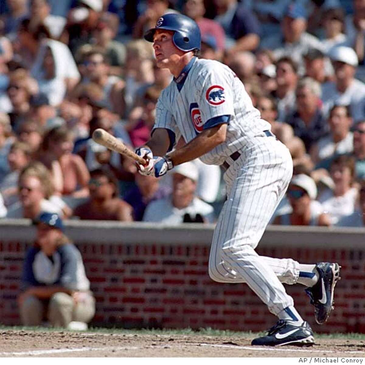 ** FILE ** Chicago Cubs Ryne Sandberg watches his home run ball against the Los Angeles Dodgers in the second inning in Chicago, in this Aug. 2, 1997 photo. Sandberg and Wade Boggs were elected to the Baseball Hall of Fame on Tuesday Jan. 4, 2005. (AP Photo/Michael Conroy)