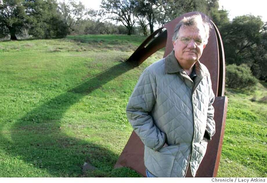 """Steve Oliver in front of Roger Berry's """"Darwin"""" art installation which with the sun shinning through its arch reflexs a shadow, on his property in Geyserville, Dec. 31, 2004. Steve Oliver, the chairman of the board of SFMOMA, at his ranch in Geyserville where he is a major collector of sculpture, Dec. 30, 2004.  LACY ATKINS/SAN FRANCISCO CHRONICLE Photo: LACY ATKINS"""