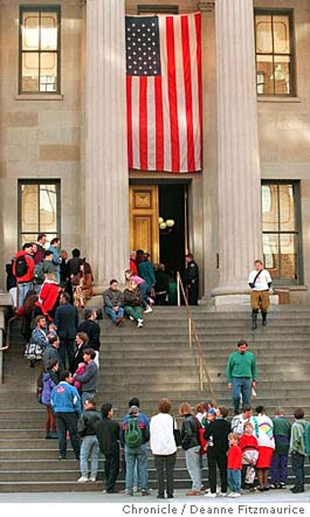 VISITORS WAIT ON THE STEPS OUTSIDE THE OLD MINT DURING ITS FINAL DAY.