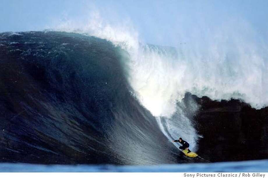 "Peter Mel surfs at Northern California's popular surf spot Mavericks in a scene from Sony Pictures Classics' documentary ""Riding Giants,"" in this undated promotional photo. Encouraged by enthusiastic crowds at film festivals that showcase documentaries, distributors are snapping up nonfiction films and theaters are more inclined to book them. (AP Photo/Sony Pictures Classics / Rob Gilley) Photo: ROB GILLEY"