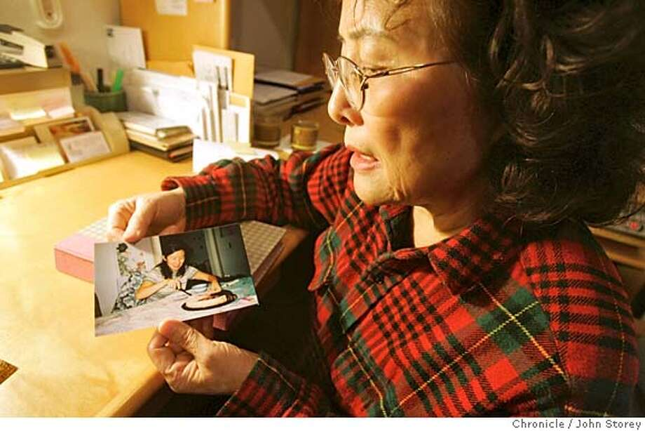 Tsunami_140_jrs.jpg  Ren Guo with pictures of her daughter, You-Jin Zhu, who is missing in Burma after the Tsunami hit Southeast Asia at her home in Half Moon Bay. John Storey/The Chronicle MANDATORY CREDIT FOR PHOTOG AND SF CHRONICLE/ -MAGS OUT Photo: John Storey