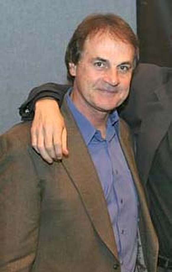 Photo released by The Recording Academy shows St. Louis Cardinals manager Tony La Russa, left, and old friend, legendary rocker Bruce Hornsby at a National Academy of Recording Arts & Sciences ceremony in Washington, Monday, Dec. 14, 2004. La Russa presented the Governors' Award to Hornsby for his contributions to the music industry. The two have been friends since 1998 when Hornsby played at a benefit for La Russa's Animal Rescue Foundation in California.(AP Photo/Jim Saah, The Recording Academy) , Photo: JIM SAAH