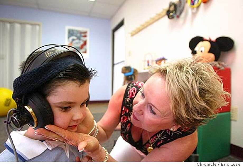 Dr. Deborah Swain,(right) tries refocusing Joey during a theraphy session. She is one of America�s leading experts on the Tomatis Method of therapeutic listening, recently received federal $$ to study the efficacy of this method, a treatment for learning, speech, balance, and emotional disorders. Joey Parrick,5, Petaluma going through a session at The Swain Center in Santa Rosa for his autism.  Event on 6/14/04 in Santa Rosa. Eric Luse / Photo: Eric Luse