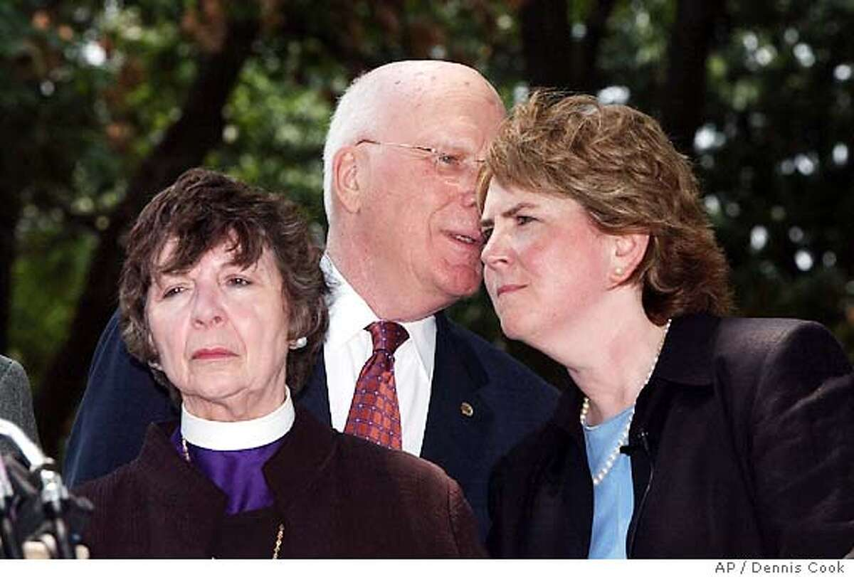 Senator Patrick Leahy, D-Vt., talks to Human Right Campaign President Cheryl Jacques on Capitol Hill Wednesday, July 14, 2004, after Democrats, joined by six Republicans, defeated an attempt to amend the consitution to ban . Bishop Jane Dixon is at right. (AP Photo/Dennis Cook)