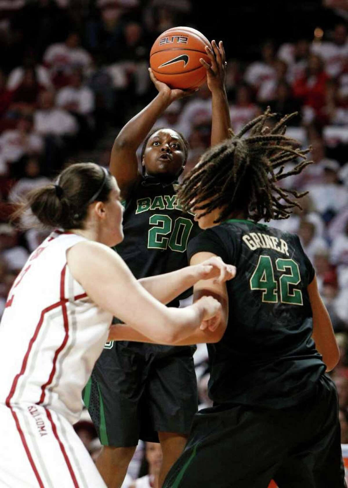 Baylor's Terran Condrey (middle), who had 14 points, gets room to fire off a jumper in the first half Thursday.