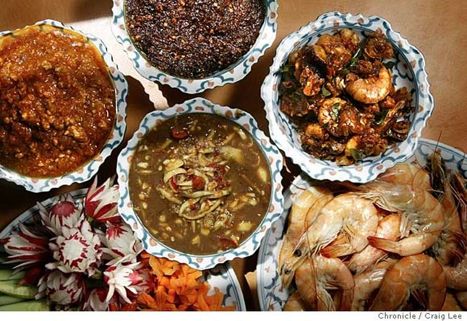 Photo of four nampriks in the small bowls, clockwise from the top: Dadang (from the north eastern region of Thailand), Gung Seap (southern region), Platu (central region), Ong (northern region). The plate of cut vegetables and the shrimp are waht you dip into the nampriks. Story on Anond Pinsuvana (right), a young Thai chef in San Francisco, works with his mother, Malulee Pinsuvana, a cooking teacher who is visiting from Thailand, on various nampriks, the salsas of Thai cuisine.  Event on 4/22/04 in San Francisco. Craig Lee / The Chronicle Photo: Craig Lee