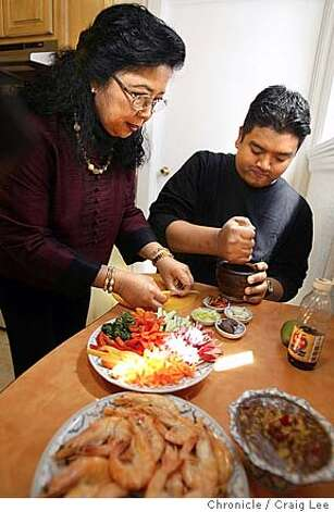 Anond Pinsuvana (right), a young Thai chef in San Francisco, works with his mother, Malulee Pinsuvana (left), a cooking teacher who is visiting from Thailand, on various nampriks, the salsas of Thai cuisine.  Event on 4/22/04 in San Francisco. Craig Lee / The Chronicle Photo: Craig Lee