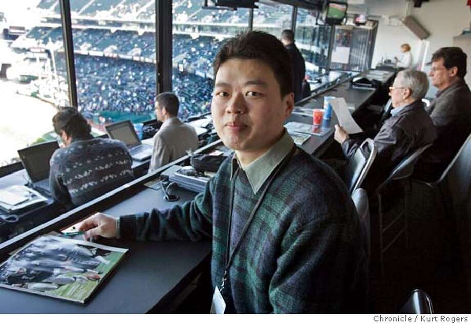 Tao Zhang in the press box before the start of the Raiders game. He writes articles for the Raiders Mandarin-language Web site. He is featured in a story about Bay Area sports teams, specifically the Raiders and Warriors, who are trying to expand their fan base by appealing to ethnic groups such as Latinos and Chinese Americans  _P4A0007.JPG 12/19/04 in Oakland,CA.  KURT ROGERS/THE CHRONICLE MANDATORY CREDIT FOR PHOTOG AND SF CHRONICLE/ -MAGS OUT Photo: KURT ROGERS