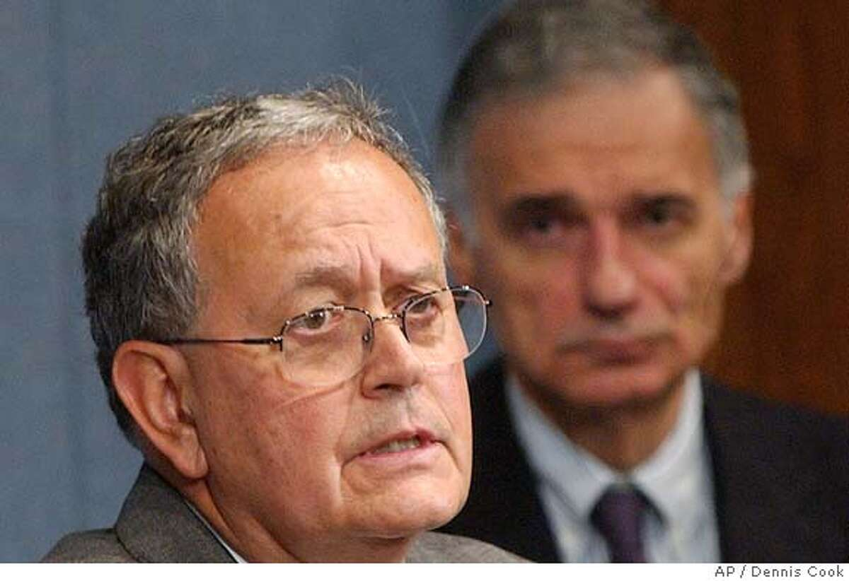 California businessman Peter Miguel Camejo talks to reporters in Washington Monday, June 21, 2004, after being picked by presidential candidate Ralph Nader, right, as his running mate (AP Photo/Dennis Cook).