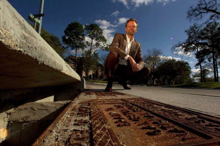 Hunters Creek Village Mayor David Wegner says city officials discovered that the 4-foot-deep flooding on Kemwood Drive on Jan. 9 had been caused by the near-total bricking up of a storm drain in Piney Point Village. Photo: Johnny Hanson / © 2012  Houston Chronicle