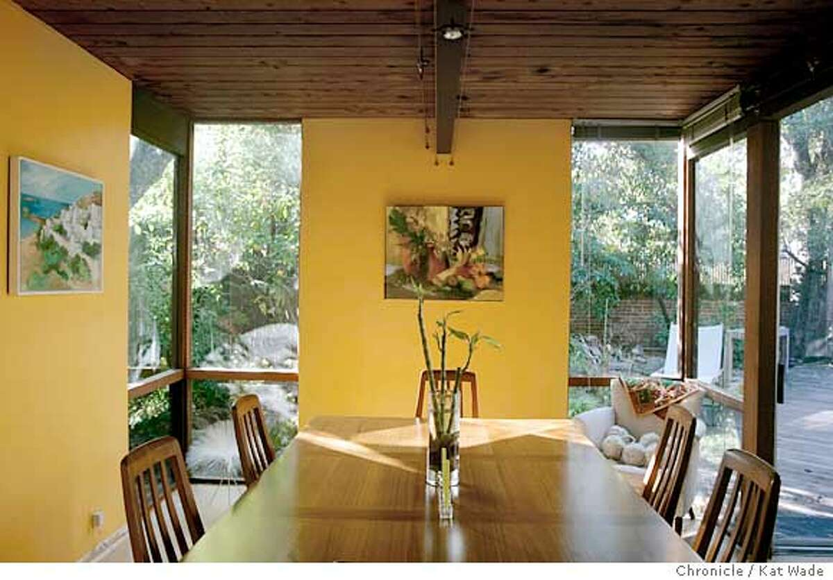 On 12/19/04 in Palo Alto Marie-Jo Fremont and her husband Brian Tucker own possibly the last Eichler home designed by architect Claude Oakland with walls of glass and soaring ceilings. Chronicle Photo by Kat Wade