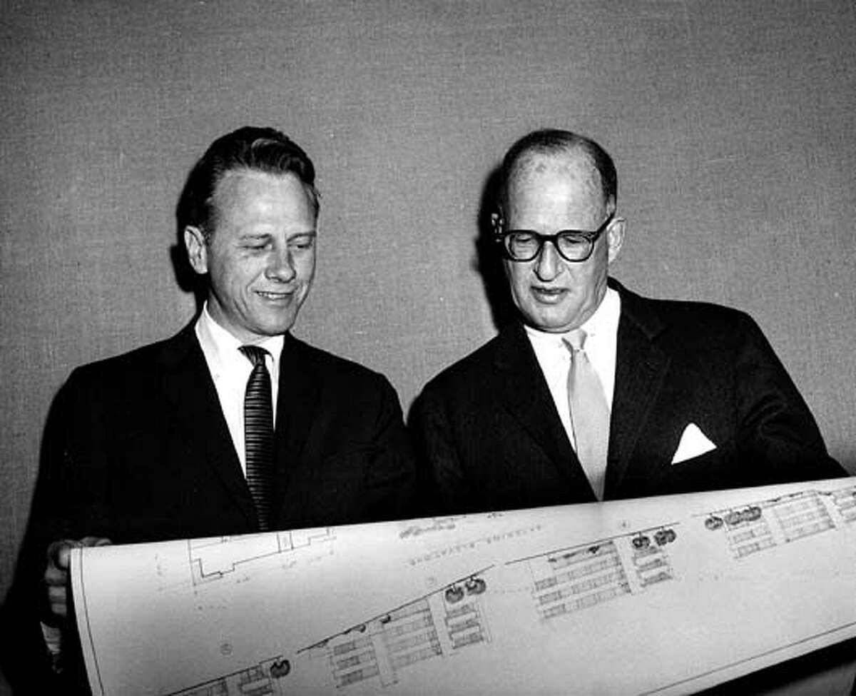 Photo of architect Claude Oakland with Joe Eichler from 1962. In the photo, they are reviewing plans for the Pomeroy Green and West developments of Santa Clara that Oakland designed for Eichler.