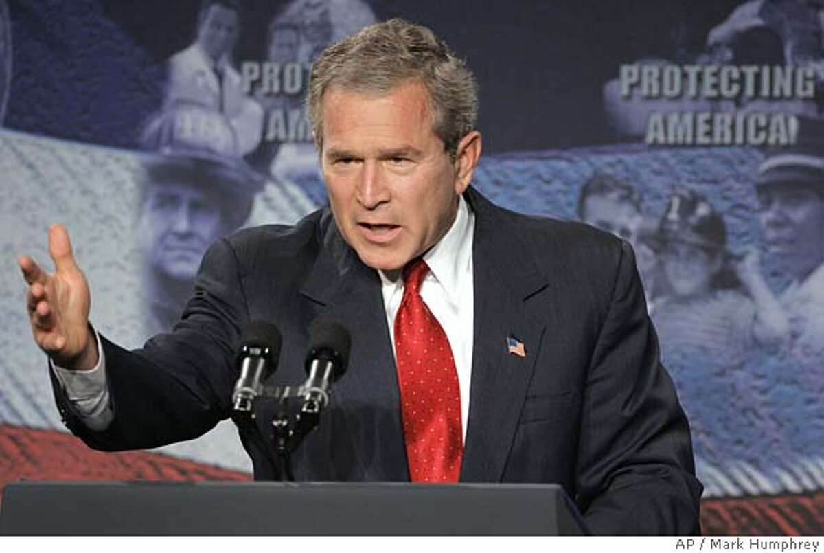 """President Bush speaks at the Oak Ridge National Laboratory in Oak Ridge, Tenn., on Monday, July 12, 2004. Bush defended his decision to invade Iraq even as he conceded on Monday that investigators had not found the weapons of mass destruction that he had warned the country possessed. """"Although we have not found stockpiles of weapons of mass destruction, we were right to go into Iraq,"""" Bush said after inspecting a display of nuclear weapons parts and equipment from Libya, which were sent to Oak Ridge as part of an agreement with Moammar Gadhafi to end his country's nuclear weapons program. (AP Photo/Mark Humphrey)"""