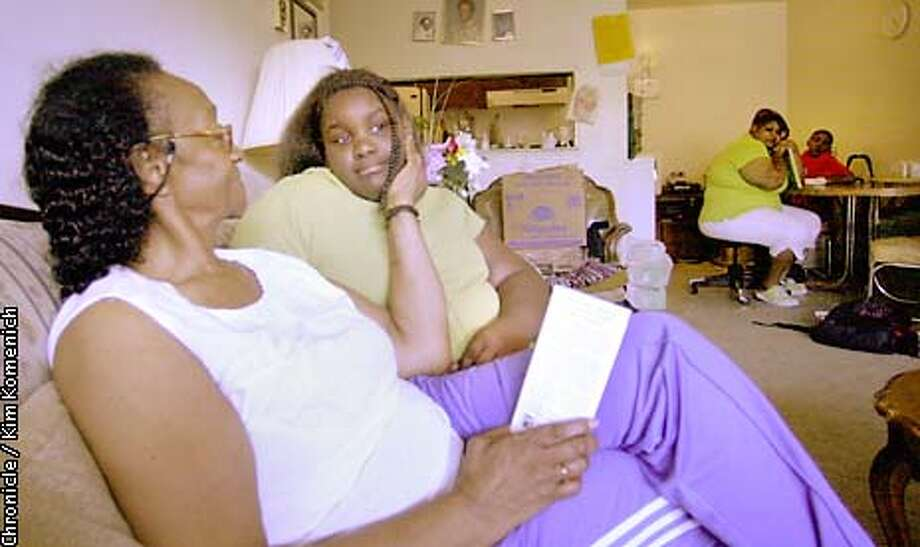 FATKIDS12L-C-11MAY02-MT-KK  Lillian Ford touches her granddaughter Shirliesa Rogers after Shirliesa finished her homeschooling class with her mother and brother (bkgd). Shirliesa has to monitor her blood sugar at least twice a day.  We look into the alarming rise of juvenile onset diabetes. CHRONICLE PHOTO BY KIM KOMENICH