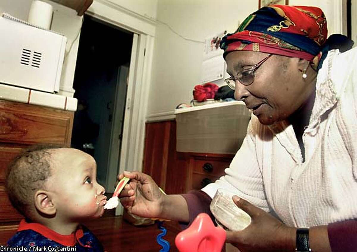 Rosalie feeds 8-month-old Demetrius. Chronicle photo by Mark Costantini