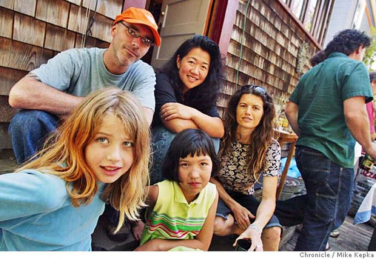 Documentary film maker, Morgan Paar (back left), is heading up a team of Two Berkeley 5th graders, Tiana Miller-Leonard, 9 (front left), and Nicola Michael-Tsai (front right), are starting a round the world tour Sunday where they will work on a series of documentary films on 800 passanger ship called The Peace Boat. Also go on the trip is the girl's mother's (back middle) Cindy Tsai and Jeni Miller. MIKE KEPKA/The Chronicle