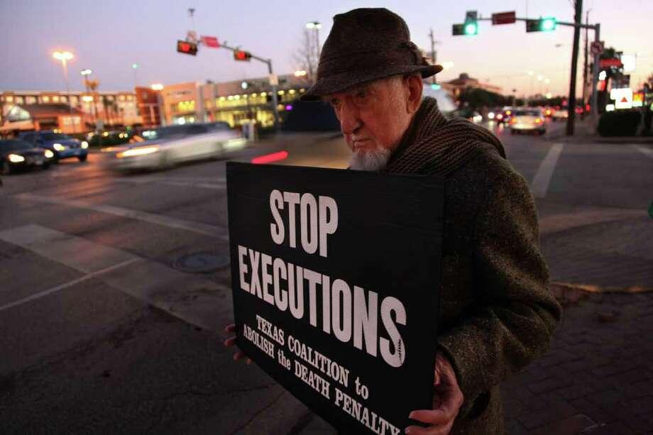 Burnham Terrell, 88, participates in a vigil Thursday for killer Rodrigo Hernandez by the Houston chapter of the Texas Coalition to Abolish the Death Penalty. Photo: Mayra Beltran / © 2012 Houston Chronicle
