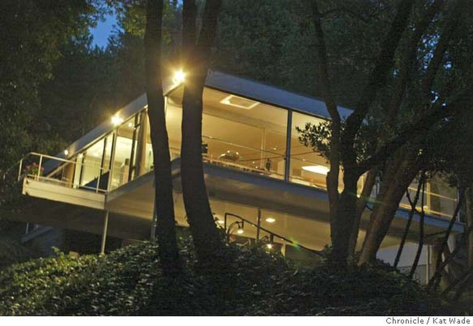 Donald Olsen designed his own home with the glass walls and prominent geometry characteristic of European modernism. Chronicle photo by Kat Wade