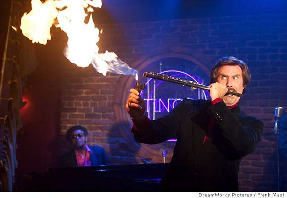 AM12Ron Burgundy (WILL FERRELL) shows off his red hot flute-playing in DreamWorks Pictures� comedy ANCHORMAN: THE LEGEND OF RON BURGUNDY.  Photo: Frank Masi, SMPSP