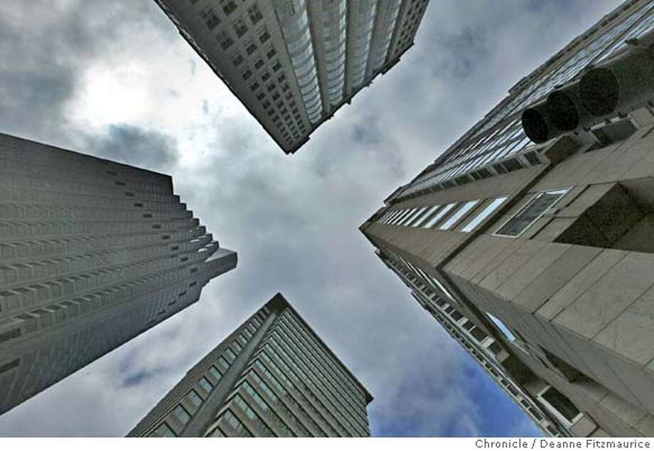 Bank of America at left and at lower center is 601 California which is for sale. Skycrapers at Kearny and California. Commercial buildings in downtown San Francisco are once again on the market after tough times since the dot-com boom.  Deanne Fitzmaurice / The Chronicle Photo: Deanne Fitzmaurice