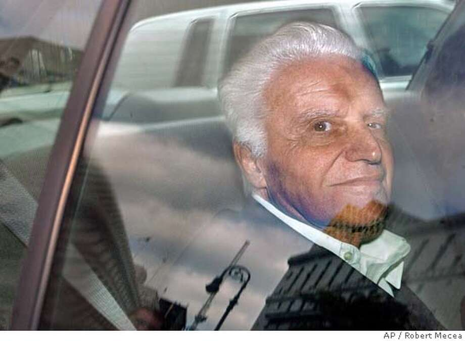 John Rigas, the founder of cable television giant Adelphia Communications Corp., is driven into federal court in Manhattan, Wednesday, July 24, 2002, in New York. Rigas along with two of his sons was arrested on conspiracy charges and accused of looting the now-bankrupt company. (AP Photo/Robert Mecea) Photo: ROBERT MECEA