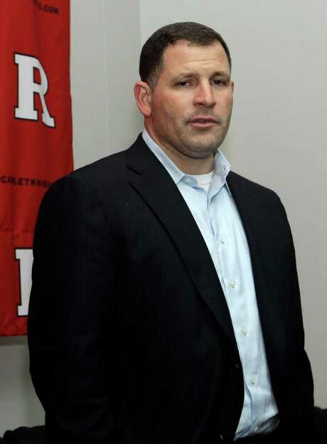 "Rutgers football coach Greg Schiano pauses as he answers a question while talking with a group of reporters in Piscataway, N.J., Thursday, Jan. 26, 2012, after it was announced that he had accepted an offer to coach the NFL's Tampa Bay Buccaneers.  Rutgers athletic director Tim Pernetti says a new coach will be hired ""as soon as possible"" but did not guarantee that a hire would be made before signing day on Wednesday. (AP Photo/Mel Evans) Photo: Mel Evans / AP"