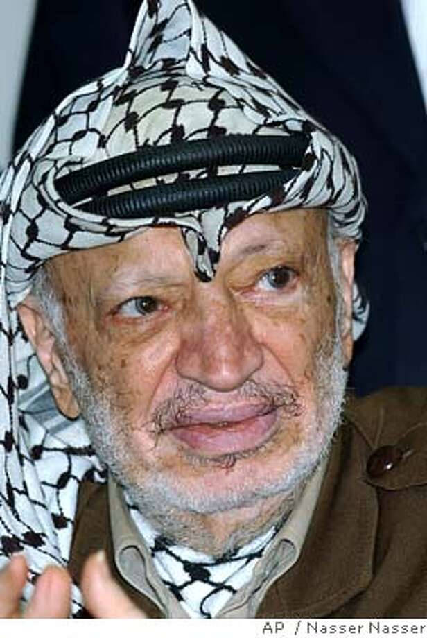 Palestinian leader Yasser Arafat attends a meeting with supporters at his compound in the West Bank town of Ramallah, Thursday, July 1, 2004. (AP Photo/Nasser Nasser) Photo: NASSER NASSER