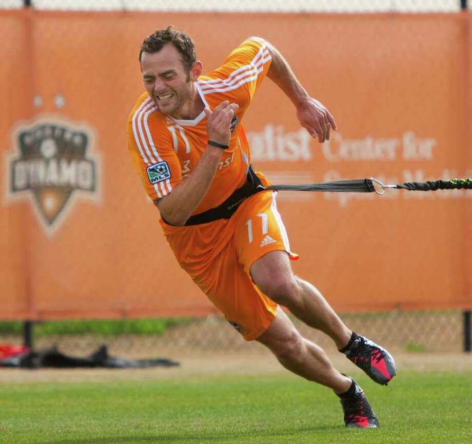 Dynamo midfielder Brad Davis practices during the team's first training session. Photo: Andrew Richardson, For The Chronicle / © 2012 Andrew Richardson