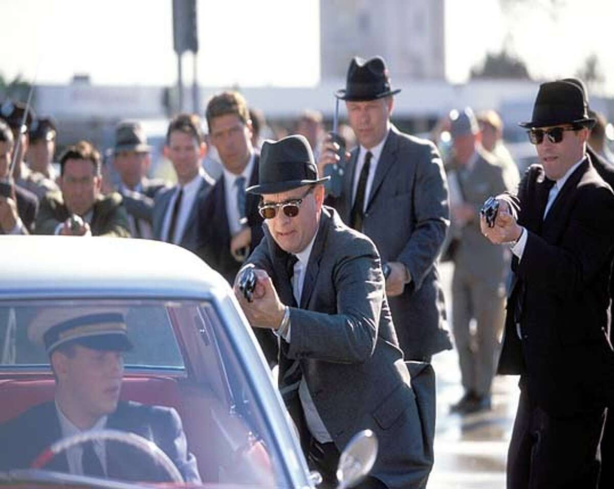 FBI agents led by Carl Hanratty (Tom Hanks) think they've cornered an elusive con man in Steven Spielberg's