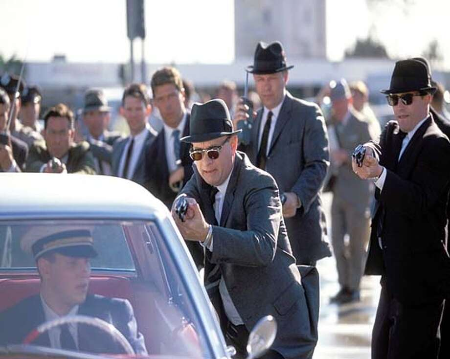 "FBI agents led by Carl Hanratty (Tom Hanks) think they've cornered an elusive con man in Steven Spielberg's ""Catch Me If You Can.''"