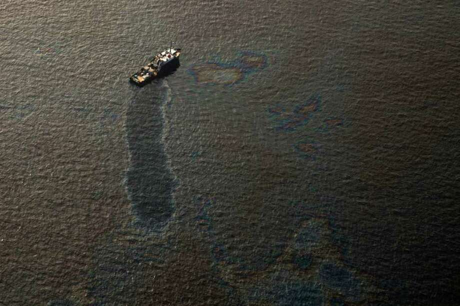 Oil surrounds a boat near the site of the Deepwater Horizon tragedy in June 2010. A judge made a ruling Thursday on pollution claims. Photo: Smiley N. Pool / Houston Chronicle