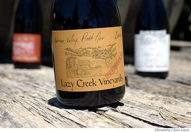 Lazy Creek Winery, Pinot Noir producer in the Anderson Valley. The mailbox and sign along Hwy 128. Bottles of Reserve, Estate and Table Red against a backdrop of an old truck that was hauled out of the vineyard. All Pinot  Eric Luse / The Chronicle Photo: Eric Luse