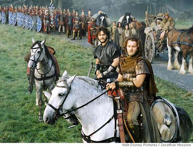 Arthur�s Knights of the Round Table, including Galahad (Hugh Dancy, center) and Gawain (Joel Edgerton, right) stand ready to protect the traveling caravan. Photo: Jonathan Hession