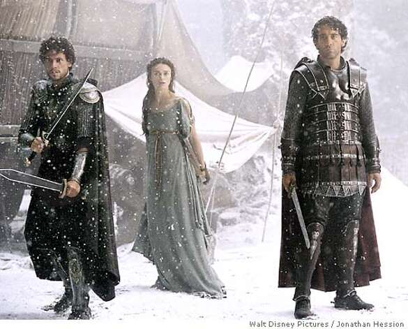 "** ADVANCE FOR WEDNESDAY JULY 7 **Lancelot, played by actor Ioan Gruffudd, left, Guinevere, played by Keira Knightley and Arthur, played by Clive Owen, stand united in facing danger in a scene from Walt Disney Pictures ""King Arthur,"" in this undated promotional photo. This version of the Arthurian legend dispenses with many traditional trappings such as the love triangle among Arthur, Guinevere and Lancelot, Merlin as a sorcerer and other supernatural elements. (AP Photo/Jonathan Hession, Walt Disney Pictures / Jonathan Hession) Photo: JONATHAN HESSION"