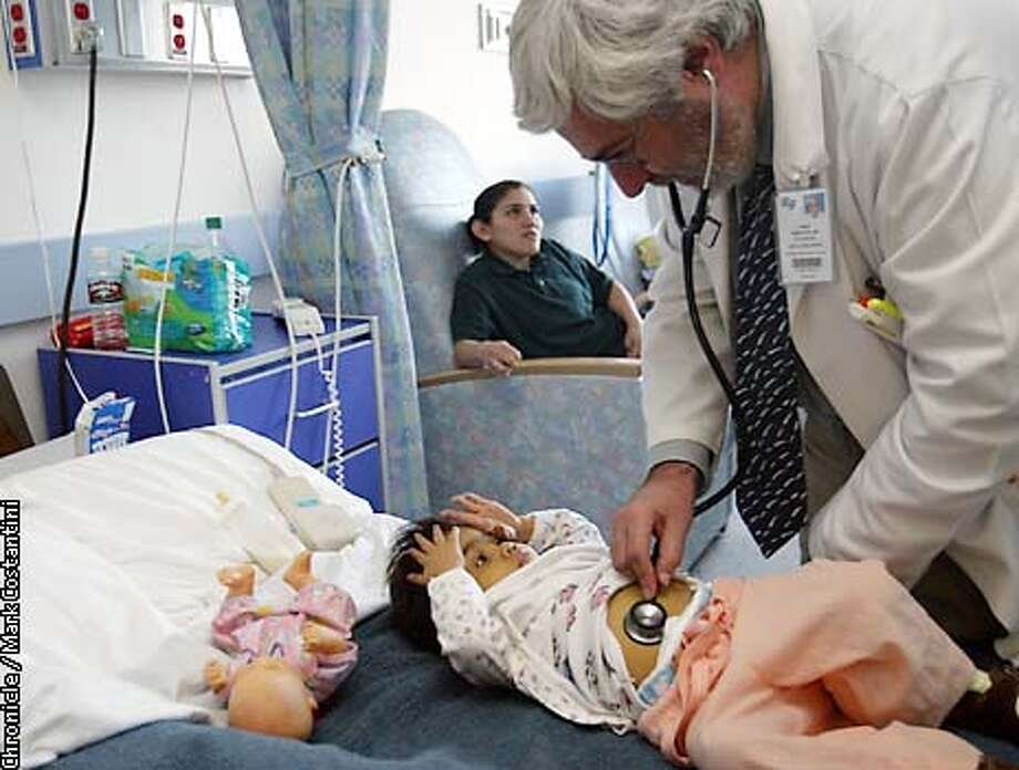 SANGSTAT1-C-20NOV02-BU-DF  Philip Rosenthal, MD, Director, Pediatric Hepatology and Medical Director, Pediatric Liver Transplant Program at UCSF examines his patient, Jessie Villavicencio, 3, who is rejecting her newly transplanted liver and is awaiting another transplant surgery. Her mother, Marlene is in the background.  CHRONICLE PHOTO BY DEANNE FITZMAURICE