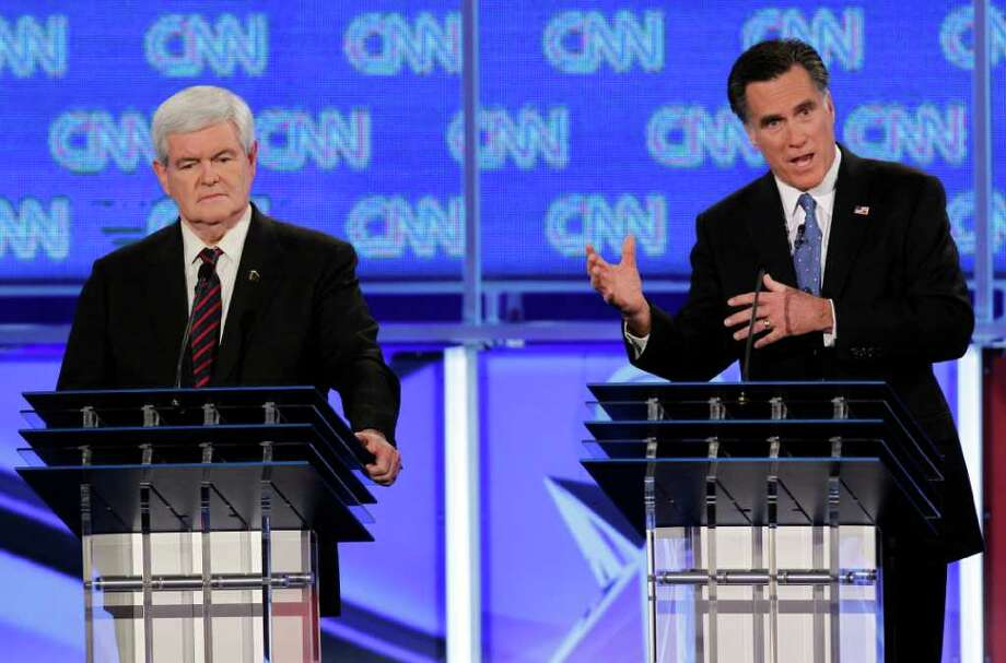 There were four candidates in Thursday's debate, but most of the action involved the two leading candidates, Mitt Romney and Newt Gingrich. The two clashed as the latest polls signaled a volatile race, with one reporting Romney was surging. Photo: Matt Rourke / Copyright 2012 The Associated Press. All rights reserved. This material may not be published, broadcast, rewritten or redistribu
